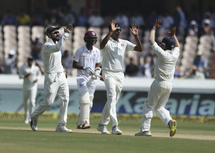 Indian bowler Ravichandran Ashwin celebrates the wicket of West Indies player Kieran Powell during the first day of the second cricket test match between India and West Indies in Hyderabad, India, Friday, Oct. 12, 2018. (AP Photo/Mahesh Kumar A.)
