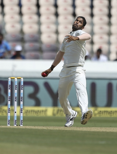 Indian cricketer Umesh Yadav bowls during the first day of the second cricket test match between India and West Indies in Hyderabad, India, Friday, Oct. 12, 2018. (AP Photo/Mahesh Kumar A.)