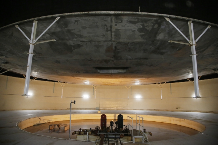 "This July 31, 2015 photo shows inside the South Lung, one of two large, above-ground domes that contain the biosphere's ""lungs"" or huge chambers that regulate air pressure inside the glass buildings at the Biosphere 2 in Oracle, Ariz. University of Arizona officials say that 25 years after that New Age-style experiment in the Arizona desert, the glass-covered greenhouse thrives as a singular site for researchers from around the world studying everything from the effects of the ocean's acidification on coral to ways of ensuring food security. (AP Photo/Ross D. Franklin)"