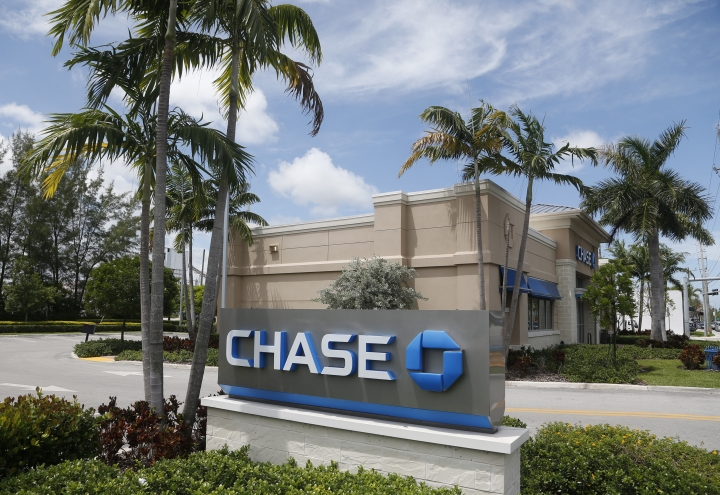 FILE - This Aug. 17, 2016, file photo, shows a Chase bank branch in North Miami Beach, Fla. JPMorgan Chase & Co. reports earnings Friday, Oct. 12, 2018. (AP Photo/Wilfredo Lee, File)