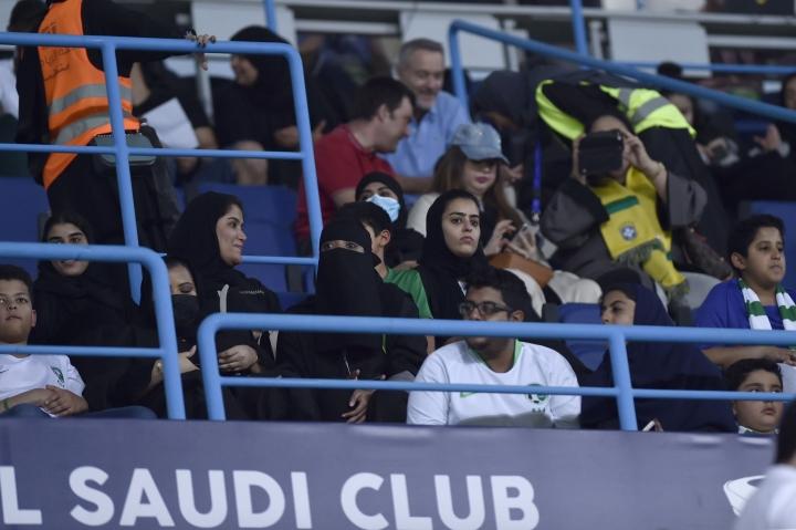Saudi women watch a friendly soccer match between Brazil and Saudi Arabia at King Saud university stadium in Riyadh, Saudi Arabia, Friday, Oct. 12, 2018. (AP Photo)