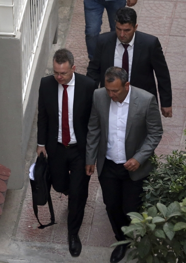 US Pastor Andrew Brunson, front left, arrives at home after his release, following his trial in Izmir, Turkey, Friday, Oct. 12, 2018, A Turkish court on Friday convicted an American pastor of terror charges but released him from house arrest and allowed him to leave Turkey, in a move that is likely to ease tensions between Turkey and the United States. (AP Photo/Emre Tazegul)