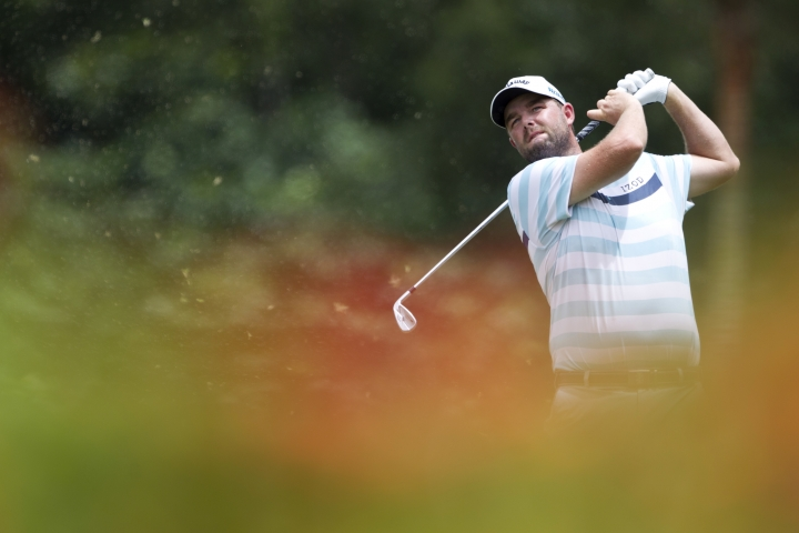 Marc Leishman of Australia follows his shot on the eighth hole during the third round of the CIMB Classic golf tournament at Tournament Players Club (TPC) in Kuala Lumpur, Malaysia, Saturday, Oct. 13, 2018. (AP Photo/Yam G-Jun)