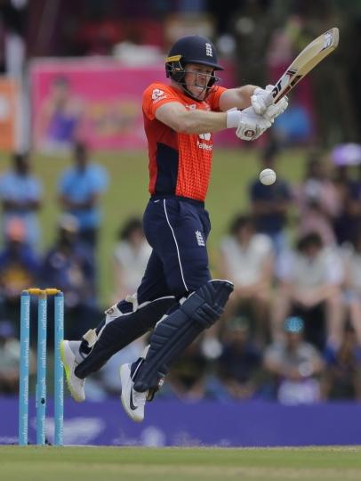 England's Eoin Morgan plays a shot during their second one-day international cricket match with Sri Lanka in Dambulla, Sri Lanka, Saturday, Oct. 13, 2018. (AP Photo/Eranga Jayawardena)