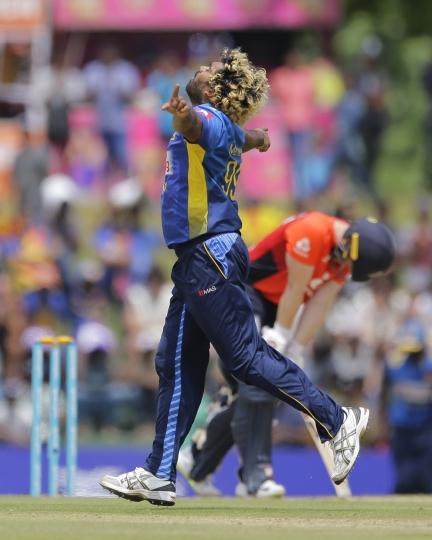 Sri Lanka's Lasith Malinga celebrates the dismissal of England's Eoin Morgan during their second one-day international cricket match in Dambulla, Sri Lanka, Saturday, Oct. 13, 2018. (AP Photo/Eranga Jayawardena)