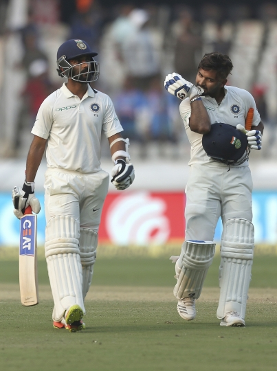 Indian cricketer Ajinkya Rahane, left, Rishabh Pant walk back to the pavillion at the end of the second day of the second cricket test match between India and West Indies in Hyderabad, India, Saturday, Oct. 13, 2018. (AP Photo/Mahesh Kumar A.)