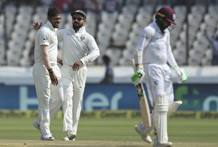 Indian bowler Umesh Yadav, left, celebrates the dismissal of West Indies' cricketer Devender Bishoo during the second day of the second cricket test match between India and West Indies in Hyderabad, India, Saturday, Oct. 13, 2018. (AP Photo/Mahesh Kumar A.)