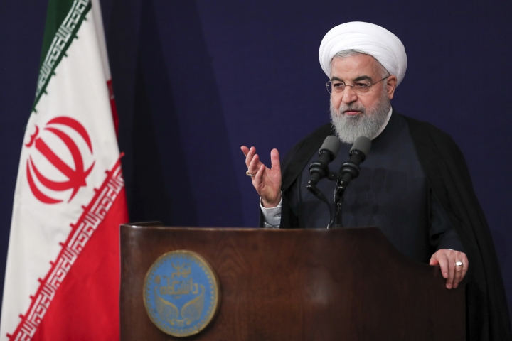 In this photo released by official website of the office of the Iranian Presidency, President Hassan Rouhani speaks in a ceremony to mark the start of the Iranian academic year at Tehran University, Iran, Sunday, Oct. 14, 2018. Rouhani on Sunday tried to downplay U.S. sanctions targeting the country's vital oil and gas sector that are set to be restored next month. (Iranian Presidency Office via AP)