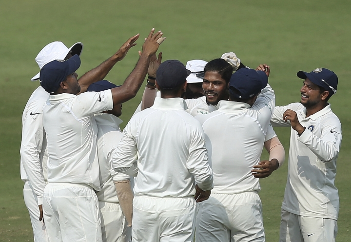 Indian bowler Umesh Yadav, third right, celebrates the dismissal of West Indies' Shane Dowrich during the third day of the second cricket test match between India and West Indies in Hyderabad, India, Sunday, Oct. 14, 2018. (AP Photo/Mahesh Kumar A.)