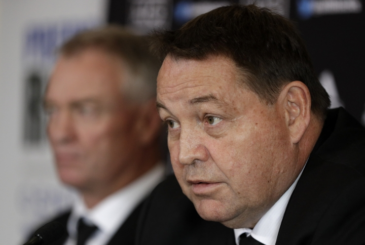 New Zealand All Blacks coach Steve Hansen, right, and selector Grant Fox answer questions during a press conference at the Prebbleton Rugby Club on the outskirts of Christchurch, New Zealand, Monday, Oct. 15, 2018. The All Blacks have taken the unprecedented step of naming a player based in Japan among an enlarged 51-man squad for autumn test matches against Australia, Japan, England, Ireland and Italy. (AP Photo/Mark Baker)