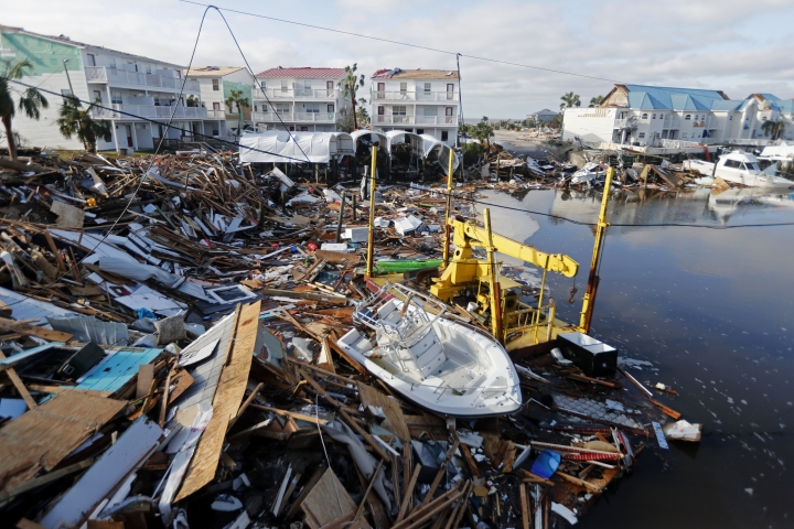 FILE - In this Oct. 11, 2018 file photo, a boat sits amidst debris in the aftermath of Hurricane Michael in Mexico Beach, Fla. Hurricane Michael has shown that President Donald Trump can't be counted on to give accurate information to the public when a natural disaster unfolds. (AP Photo/Gerald Herbert, File)