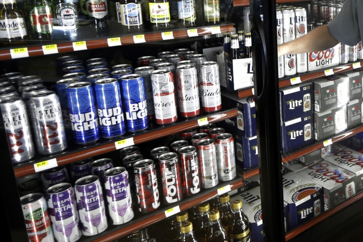 "FILE - This Wednesday, April 19, 2017 file photo shows the beer cooler behind the counter in a convenience store in Sheridan, Ind. In future sweltering years with a double whammy of heat and drought, losses of barley yield can be as much as 17 percent, computer simulations show. And that means ""beer prices would, on average, double,"" even adjusting for inflation, said a study published in the journal Nature Plants on Wednesday, Oct. 17, 2018. (AP Photo/Michael Conroy)"