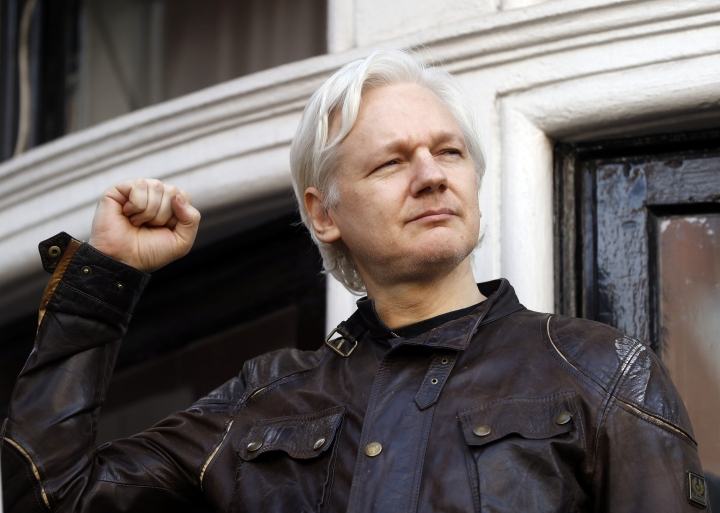FILE - In this May 19, 2017 file photo, WikiLeaks founder Julian Assange greets supporters outside the Ecuadorian embassy in London, where he has been in self imposed exile since 2012. Ecuador has formally ordered Julian Assange to steer clear of topics that could harm its diplomatic interests if he wants to be reconnected to the internet, according to a memo published in a local media outlet Monday Oct. 15, 2018. (AP Photo/Frank Augstein, file)