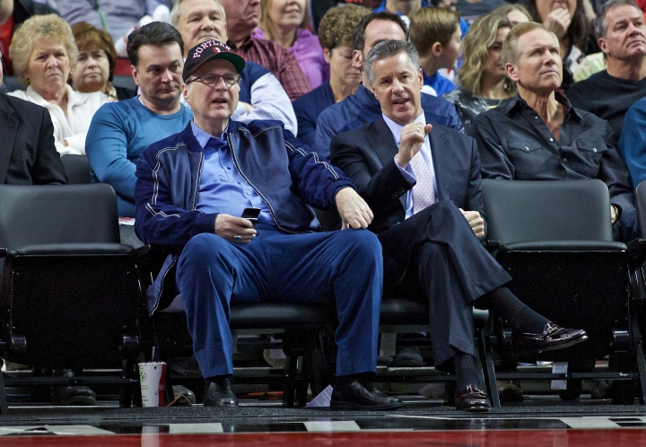 FILE - In this Jan. 10, 2016 file photo, Portland Trail Blazers owner Paul Allen, left, and general manager Neil Olshey appear during the second half of an NBA basketball game in Portland, Ore. Allen, billionaire owner of the Trail Blazers and the Seattle Seahawks and Microsoft co-founder, died Monday, Oct. 15, 2018 at age 65. Earlier this month Allen said the cancer he was treated for in 2009, non-Hodgkin's lymphoma, had returned. (AP Photo/Craig Mitchelldyer, File)