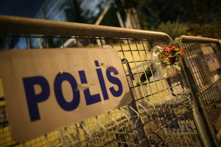 A flower bouquet is left on the police barriers blocking the road to Saudi Arabia's Consulate in Istanbul, Monday, Oct. 15, 2018. Turkish crime scene investigators dressed in coveralls and gloves entered the consulate Monday, nearly two weeks after the disappearance and alleged slaying of Saudi writer Jamal Khashoggi there. (AP Photo/Emrah Gurel)