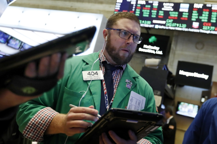 Trader Ryan Falvey works on the floor of the New York Stock Exchange, Monday, Oct. 15, 2018. Stocks are opening mostly lower as technology companies continue to fall. (AP Photo/Richard Drew)