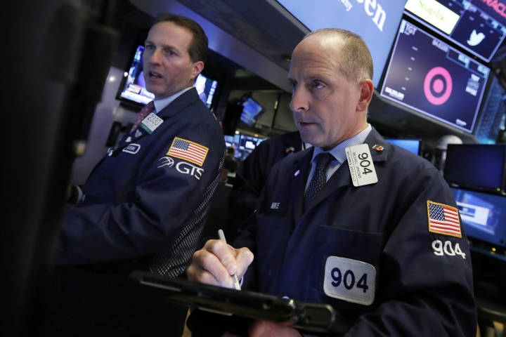 Specialist Glenn Carell, left, and trader Michael Urkonis work on the floor of the New York Stock Exchange, Monday, Oct. 15, 2018. Stocks are opening mostly lower as technology companies continue to fall. (AP Photo/Richard Drew)