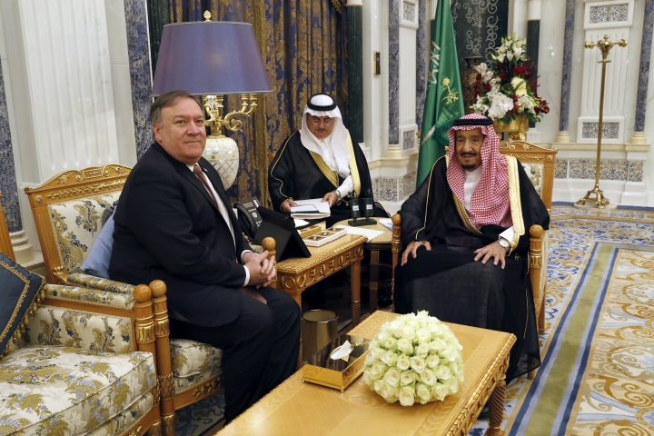 U.S. Secretary of State Mike Pompeo, left, meets with Saudi Arabia's King Salman in Riyadh, Saudi Arabia, Tuesday Oct. 16, 2018. The kingdom of Saudi Arabia has enjoyed the ultimate protected status from the United States throughout its short history. With Pompeo hastily dispatched on a damage-limitation mission to Riyadh, behind-the-scenes efforts are in full flow to preserve the Saudi-U.S. relationship in the wake of the disappearance and alleged killing of Saudi journalist Jamal Khashoggi. (Leah Millis/Pool via AP)