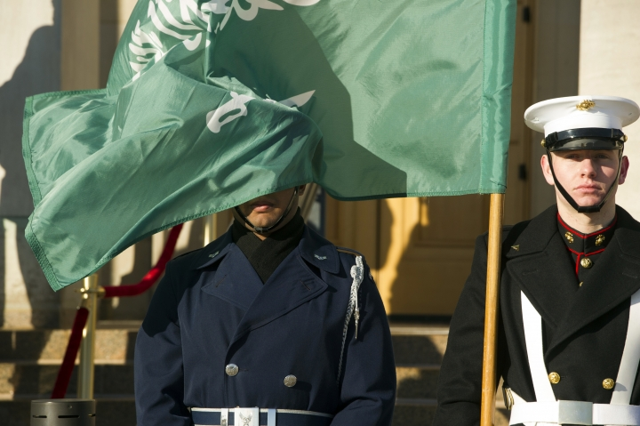 FILE - In this March 22, 2018 file photo, an honor guard member is covered by the flag of Saudi Arabia as Defense Secretary Jim Mattis welcomes Saudi Crown Prince Mohammed bin Salman to the Pentagon, in Washington. Fifteen of the 19 Sept. 11 hijackers were Saudi citizens. Much has been said of the Bush administration's decision to apportion no blame to the kingdom. The uncomfortable truth that Wahhabism, the ultraconservative Islamic doctrine Saudi's follow, has been linked to extremists at home and overseas has been carefully navigated by Washington and Riyadh. (AP Photo/Cliff Owen, File)