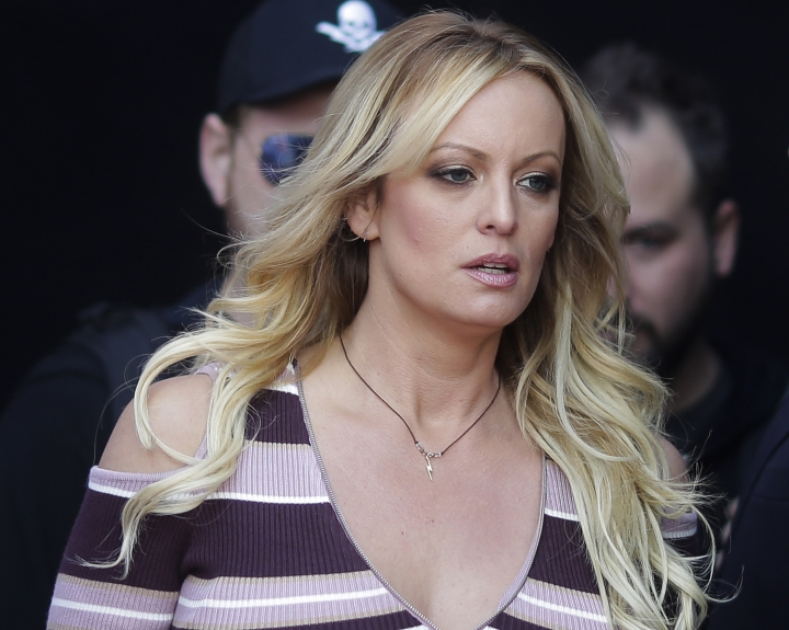 "FILE - In this Thursday, Oct. 11, 2018, file photo, adult film actress Stormy Daniels arrives for the opening of the adult entertainment fair ""Venus,"" in Berlin. On Monday, Oct. 15, 2018, a federal judge dismissed Daniels' defamation lawsuit against President Donald Trump. (AP Photo/Markus Schreiber, File)"