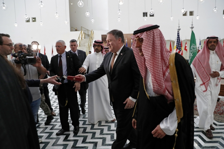 U.S. Secretary of State Mike Pompeo receives a gift during his visit to Riyadh, Saudi Arabia, Tuesday Oct. 16, 2018. Pompeo met on Tuesday with Saudi Arabia's King Salman over the disappearance and alleged slaying of Saudi writer Jamal Khashoggi, who vanished two weeks ago during a visit to the Saudi Consulate in Istanbul. (Leah Millis/Pool via AP)