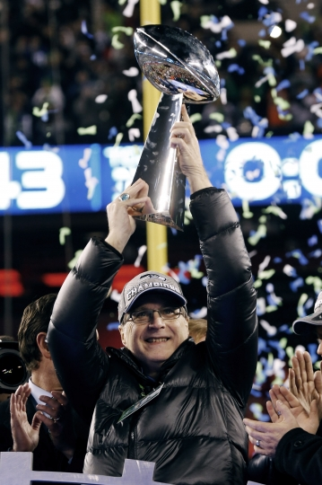 FILE - In this Feb. 2, 2014 file photo, Seattle Seahawks owner Paul Allen holds the the Vince Lombardi Trophy after the NFL Super Bowl XLVIII football game against the Denver Broncos in East Rutherford, N.J. The Seahawks won 43-8. Allen, billionaire owner of the Trail Blazers and the Seattle Seahawks and Microsoft co-founder, died Monday, Oct. 15, 2018 at age 65. Earlier this month Allen said the cancer he was treated for in 2009, non-Hodgkin's lymphoma, had returned. (AP Photo/Paul Sancya, File)