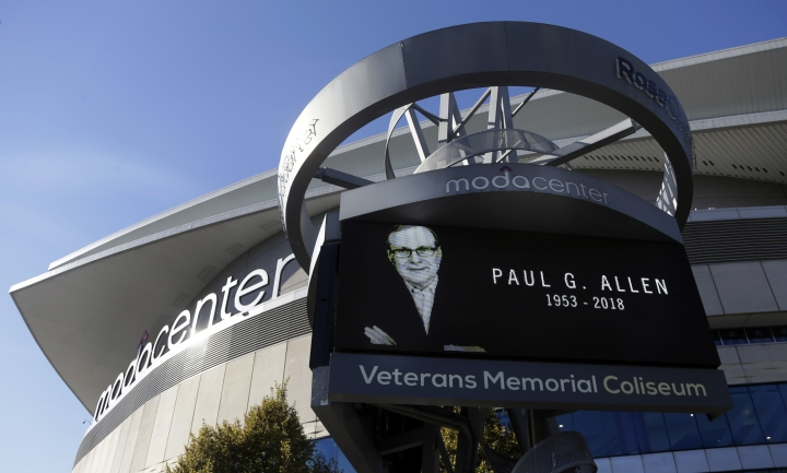 Portland Trail Blazers owner Paul Allen is memorialized on a marquee in front of the Moda Center, where the team plays, in Portland, Ore., Tuesday, Oct. 16, 2018. Allen, who co-founded Microsoft with his childhood friend Bill Gates before becoming a billionaire philanthropist, technology investor and owner of several professional sports teams, died in Seattle Monday, Oct. 15, 2018, at the age of 65. (AP Photo/Don Ryan)