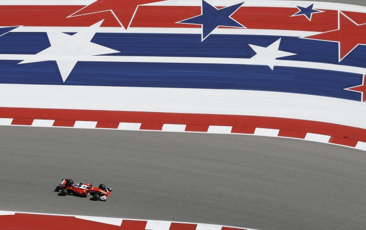 FILE - In this Oct. 21, 2016, file photo, Ferrari driver Sebastian Vettel, of Germany, steers his car during the second practice session for the Formula One U.S. Grand Prix auto race at the Circuit of the Americas, in Austin, Texas. Once there, its red-white-and-blue racing stripes announce a racetrack that has been become the heart and soul of Formula One in the U.S.(AP Photo/Darron Cummings, File)