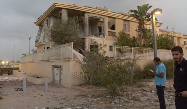 In this image made from video, police inspect the damage to a building from a rocket, Wednesday, Oct. 17, 2018, in Beersheba, Israel. The Israeli military says a rocket fired from Gaza made a direct hit on a home in southern Israel. It's the first rocket attack against Israel in months and the first that hit an Israeli home in Beersheba since the 2014 war between Israel and Gaza's militant Hamas rulers. (KAN via AP)