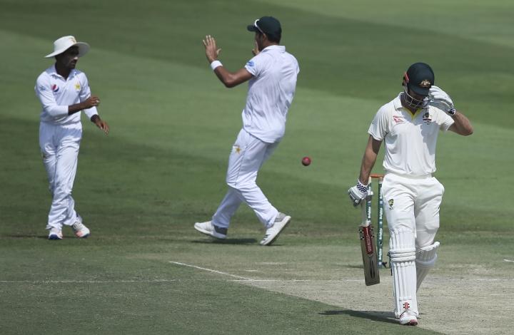 Pakistan's players celebrate dismissal of Australia's Mitchell Marsh during their test match in Abu Dhabi, United Arab Emirates, Wednesday, Oct. 17, 2018. (AP Photo/Kamran Jebreili)