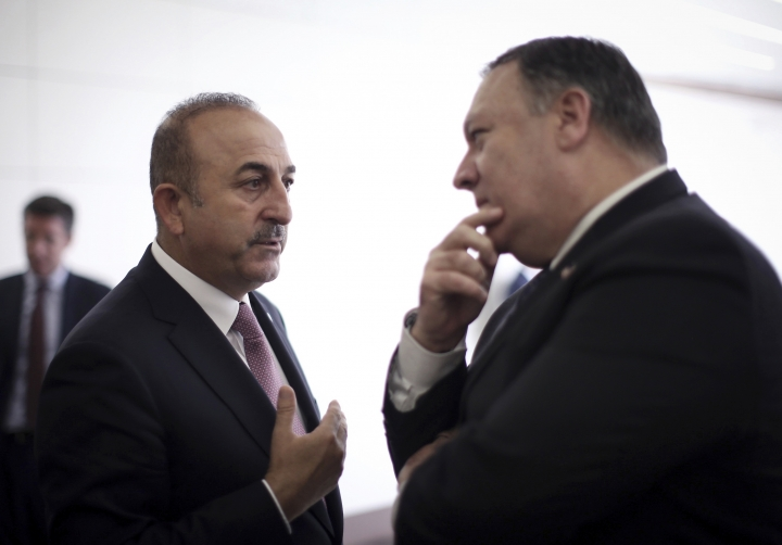 Turkey's Foreign Minister Mevlut Cavusoglu, left, talks with U.S. Secretary of State Mike Pompeo at the Esenboga Airport in Ankara, Turkey, Wednesday, Oct. 17, 2018. Pro-government newspaper Yeni Safak on Wednesday said it had obtained audio recordings of the alleged killing of Saudi writer Jamal Khashoggi inside the Saudi Arabia's consulate in Istanbul on Oct. 2.(Cem Ozdel/Turkish Foreign Ministry via AP, Pool)