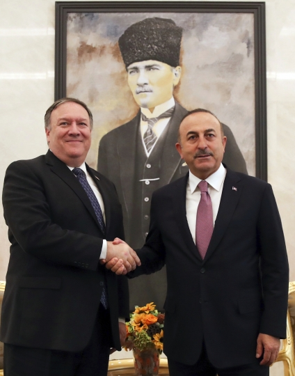 Turkey's Foreign Minister Mevlut Cavusoglu, right, and U.S. Secretary of State Mike Pompeo shake hands before a talks at the Esenboga Airport in Ankara, Turkey, Wednesday, Oct. 17, 2018. Pro-government newspaper Yeni Safak on Wednesday said it had obtained audio recordings of the alleged killing of Saudi writer Jamal Khashoggi inside the Saudi Arabia's consulate in Istanbul on Oct. 2.(Cem Ozdel/Turkish Foreign Ministry via AP)
