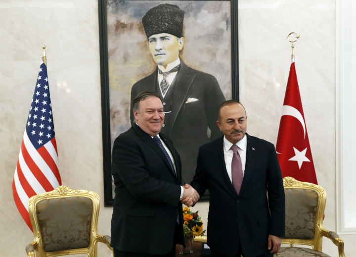 U.S. Secretary of State Mike Pompeo shakes hands with Turkish Foreign Minister Mevlut Cavusoglu before their official talks in Ankara, Turkey, Wednesday Oct. 17, 2018. On Wednesday a pro-government Turkish newspaper published a report made from what they described as an audio recording of Saudi writer and journalist Jamal Khashoggi's alleged torture and slaying at the Saudi Consulate in Istanbul. (Leah Millis/Pool via AP)