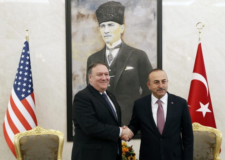 U.S. Secretary of State Mike Pompeo shakes hands with Turkish Foreign Minister Mevlut Cavusoglu before their talks in Ankara, Turkey, October 17, 2018. On Wednesday a pro-government Turkish newspaper published a report made from what they described as an audio recording of Saudi writer and journalist Jamal Khashoggi's alleged torture and slaying at the Saudi Consulate in Istanbul. (Leah Millis/Pool via AP)