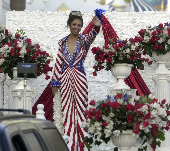 "FILE - In this Sept. 19, 2003 file photo then Miss America Erika Harold waves during the 2003 Miss America boardwalk parade in Atlantic City, N.J. Harold a Republican, now running for Illinois attorney general once said many victims of sexual harassment ""become very promiscuous"" and that young people who are called names like ""whore"" or ""slut"" think: ""that's what I want to be."" Harold is stressing her experience as an anti-bullying advocate as she seeks the job of Illinois' top legal officer. She made the comments after winning the 2003 Miss America pageant, and her campaign stood by them Wednesday, Oct. 17, 2018. ( AP Photo/Brian Branch-Price File)"