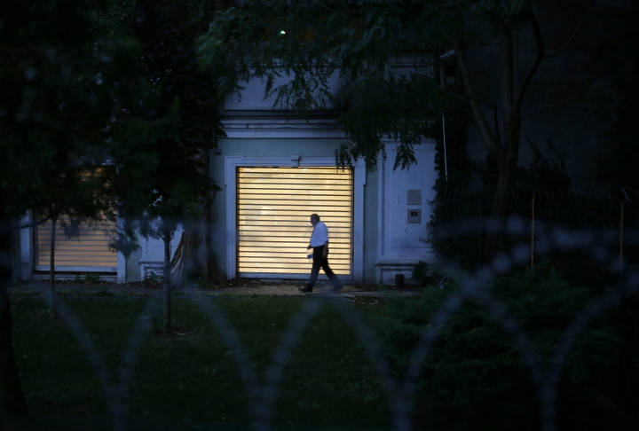 A Turkish police officer walks inside the property of the residence of the Saudi consul General Mohammed al-Otaibi as Turkish police conducted a search after the disappearance and alleged slaying of writer Jamal Khashoggi, in Istanbul, Wednesday, Oct. 17, 2018. A pro-government Turkish newspaper on Wednesday published a gruesome recounting of the alleged slaying of Saudi writer Khashoggi at the Saudi Consulate in Istanbul, just as America's top diplomat arrived in the country for talks over the Washington Post columnist's disappearance. (AP Photo/Emrah Gurel)