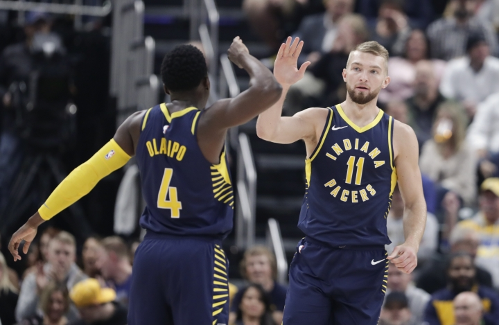 Indiana Pacers forward Domantas Sabonis (11) celebrates with guard Victor Oladipo (4) after a basket against the Memphis Grizzlies during the first half of an NBA basketball game in Indianapolis, Wednesday, Oct. 17, 2018. (AP Photo/Michael Conroy)