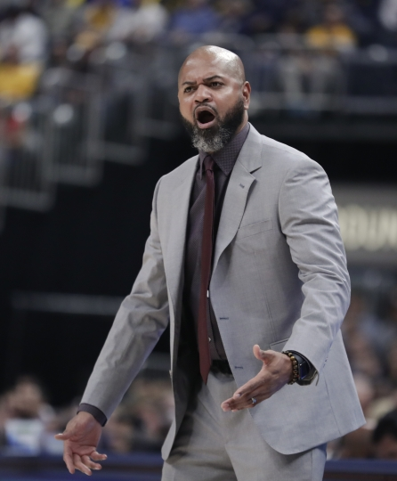 Memphis Grizzlies head coach J. B. Bickerstaff looks for a foul call as his team play against the Indiana Pacers during the first half of an NBA basketball game in Indianapolis, Wednesday, Oct. 17, 2018. (AP Photo/Michael Conroy)