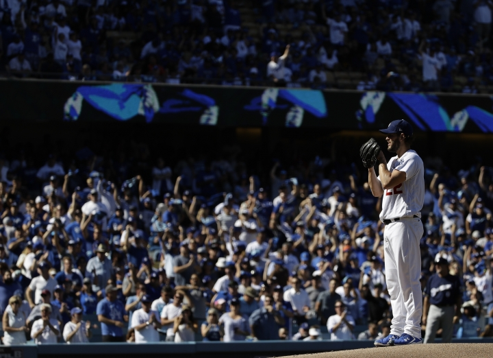 Los Angeles Dodgers starting pitcher Clayton Kershaw throws during the first inning of Game 5 of the National League Championship Series baseball game against the Milwaukee Brewers Wednesday, Oct. 17, 2018, in Los Angeles. (AP Photo/Matt Slocum)