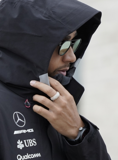 Mercedes driver Lewis Hamilton, of Britain, walks to a news conference for the Formula One U.S. Grand Prix auto race at the Circuit of the Americas, Thursday, Oct. 18, 2018, in Austin, Texas. (AP Photo/Darren Abate)