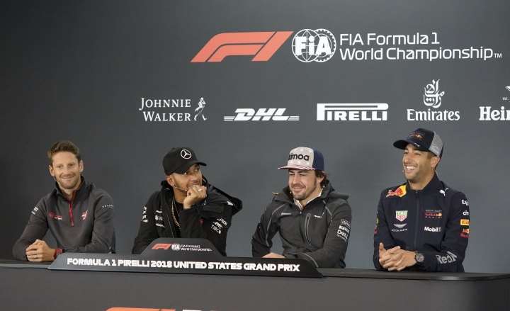 Haas driver Romain Grosjean, of France, Mercedes driver Lewis Hamilton, of Britain, McLaren driver Fernando Alonso, of Spain, from left, listen as Red Bull Racing driver Daniel Ricciardo, of Australia, speaks during a news conference for the Formula One U.S. Grand Prix auto race at the Circuit of the Americas, Thursday, Oct. 18, 2018, in Austin, Texas. (AP Photo/Darren Abate)