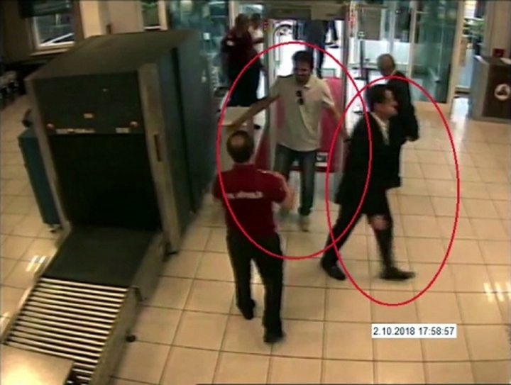 """ADDS NAME OF SUSPECT ON RIGHT- In a frame from surveillance camera footage taken Oct. 2, 2018, and published Thursday, Oct. 18, 2018, by the pro-government Turkish newspaper Sabah, a man identified by Turkish officials as Maher Abdulaziz Mutreb, right, walks at Ataturk Airport in Istanbul. Writer Jamal Khashoggi disappeared at the Saudi consulate in Istanbul on the same day. Saudi Arabia, which initially called the allegations """"baseless,"""" has not responded to repeated requests for comment from The Associated Press over recent days, including on Thursday over Mutreb's identification. (Sabah via AP)"""