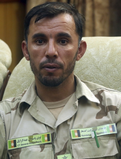 In this Aug. 4, 2016 photo, Gen. Abdul Raziq, Kandahar police chief, speaks during an interview with The Associated Press in Kandahar, Afghanistan. Three top Kandahar officials, including Raziq, were killed by their own guards Thursday, Oct. 18, 2018, although a Taliban spokesman who claimed responsibility told The Associated Press in a telephone interview that U.S Gen. Scott Miller, commander of US and NATO troops in Afghanistan was the target. Miller was unhurt but two U.S. troops were injured and evacuated. (AP Photo/Massoud Hossaini)