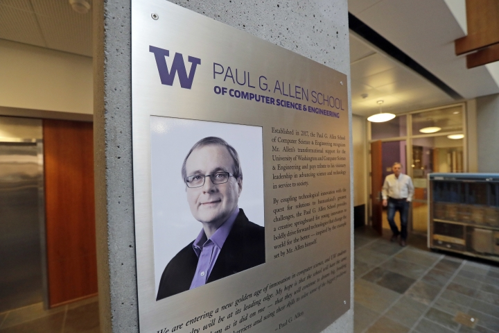 FILE- In this Monday, Oct. 15, 2018, file photo a portrait of Paul Allen stands on a wall at the Paul G. Allen School of Computer Science & Engineering at the University of Washington in Seattle. Prior to his death on Monday, Allen invested large sums in technology ventures, research projects and philanthropies, some of them eclectic and highly speculative. Outside of bland assurances from his investment company, no one seems quite sure what happens now. (AP Photo/Elaine Thompson, File)