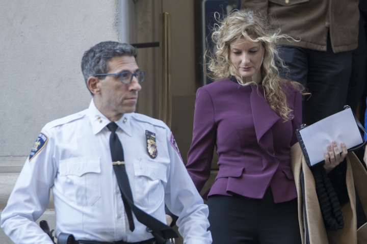 Summer Zervos, right, leaves New York state appellate court, Thursday, Oct. 18, 2018, in New York. President Donald Trump's lawyers hope to persuade an appeals court to dismiss or delay Zervos' claim that he defamed her by calling her a liar after she accused him of unwanted kissing and groping. (AP Photo/Mary Altaffer)