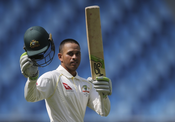 Australia's Usman Khawaja celebrates his centuray during their test match against Pakistan in Dubai, United Arab Emirates, Thursday, Oct. 11, 2018. (AP Photo/Kamran Jebreili)