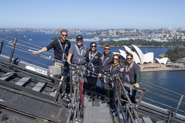 Britain's Prince Harry, left, Australia's Prime Minister Scott Morrison, second from left, and Invictus Games representatives climb the Sydney Harbour Bridge in Sydney, Tuesday, Oct. 19, 2018. Prince Harry and his wife Meghan are on day four of their 16-day tour of Australia and the South Pacific. (AP Photo/Steve Christo, Pool)
