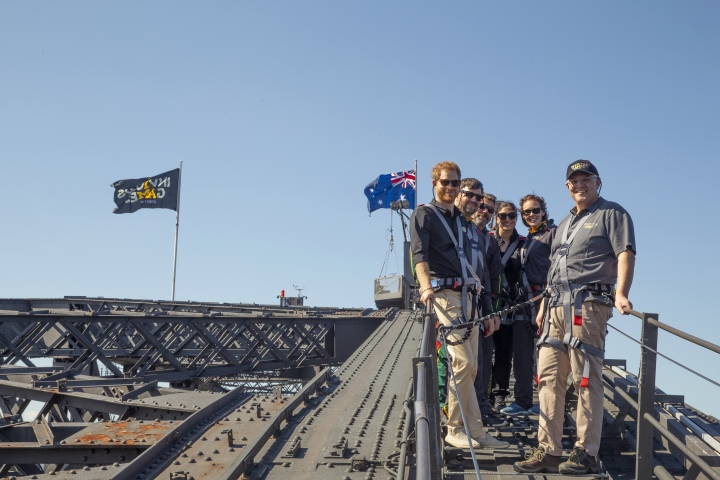 Britain's Prince Harry, left Australia's Prime Minister Scott Morrison, right, and Invictus Games representatives climb the Sydney Harbour Bridge in Sydney, Tuesday, Oct. 19, 2018. Prince Harry and his wife Meghan are on day four of their 16-day tour of Australia and the South Pacific. (AP Photo/Steve Christo, Pool)