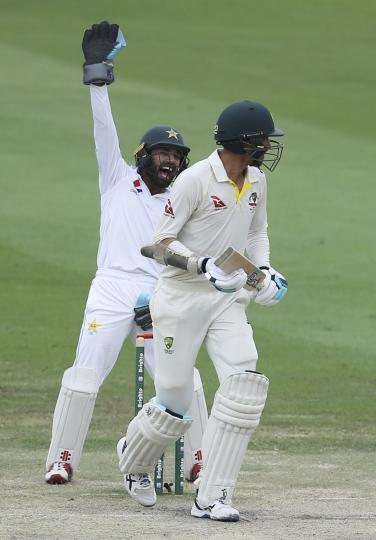 Pakistan's wicket keeper celebrates dismissal of Australia's Mitchell Starc in their test match in Abu Dhabi, United Arab Emirates, Friday, Oct. 19, 2018. (AP Photo/Kamran Jebreili)