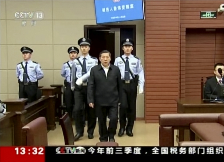 In this image made from video, Lu Wei, fourth from left, former minister of China's Cyberspace Administration, is escorted by police officers to his trial in the city of Ningbo in eastern China's Zhejiang province, Friday, Oct. 19, 2018. China's former internet censor, who once held high-profile meetings with industry leaders such as Apple chief executive Tim Cook and Facebook founder Mark Zuckerberg, stood trial on Friday on corruption allegations. (CCTV via AP)